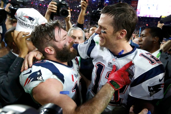 New England Patriots quarterback Brady is embraced by wide receiver Edelman after their team defeated the Seattle Seahawks in the NFL Super Bowl XLIX football game in Glendale