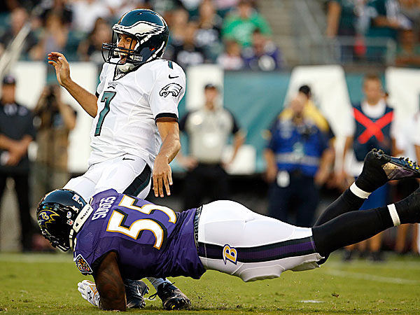 Eagles' Sam Bradford gets hit by Baltimore Ravens' Terrell Suggs in the first-quarter during a preseson game on Saturday, August 22, 2015 in Philadelphia. Suggs was pentalized on the play. ( YONG KIM / Staff Photographer )