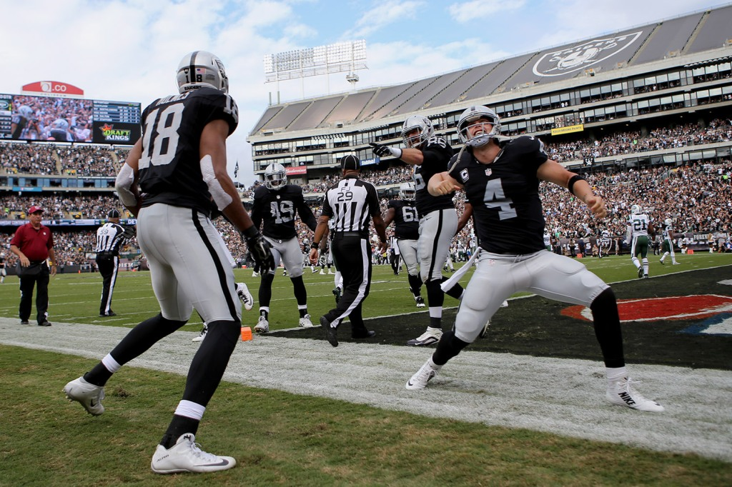 Oakland Raiders quarterback Derek Carr (4) celebrates a TD as the New York Jets face the Oakland Raiders at O.co Coliseum in Oakland, Calif., on Sunday, November 1, 2015.