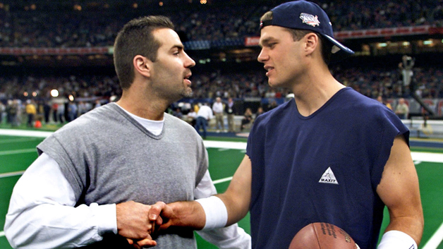 New England Patriots quarterback Tom Brady (R) cha